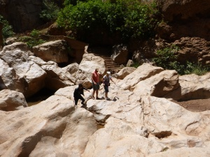 Scrambling Over Boulders To Natural Cave